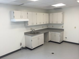 Commercial cabinets in break area in local Tulsa business.