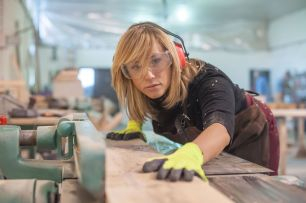 Woman cabinet maker working on built in furniture in Tulsa.